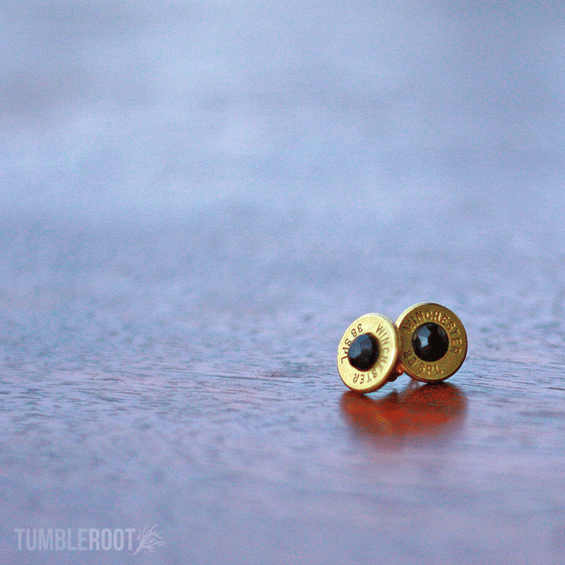 Stud earrings made from actual bullets. The perfect amount of bad-ass. Pictured: Brass with Black Rhinestones.