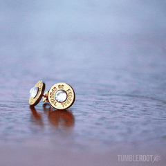 Stud earrings made from actual bullets. The perfect amount of bad-ass. Pictured: Brass with Clear Rhinestones.