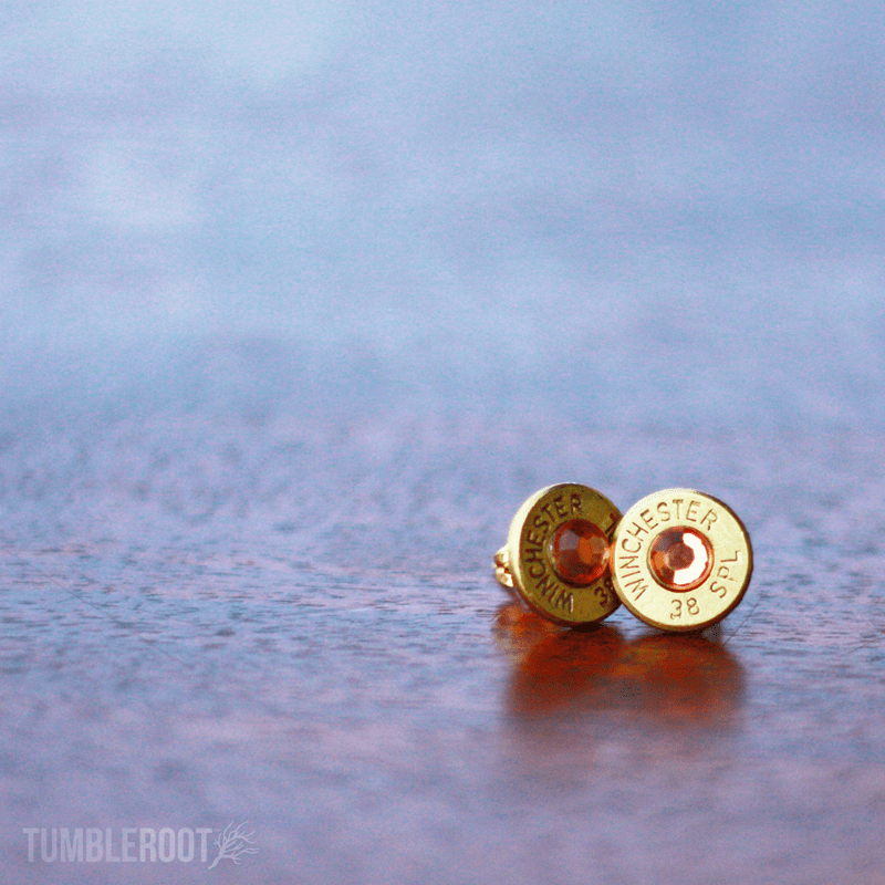 Stud earrings made from actual bullets. The perfect amount of bad-ass. Pictured: Brass with Honey Rhinestones.