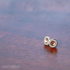 Stud earrings made from actual bullets. The perfect amount of bad-ass. Pictured: Chrome with Honey Rhinestones.