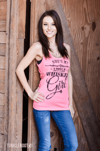 Adorable She's my Little Whiskey girl Country music tank top in neon pink - perfect for a country concert! Erica is 5'4 and wearing a size Extra Small.