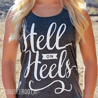 "Adorable country girl racerback tank top ""Hell on Heels"" the perfect country concert tank top. Brandi is 5'2 and wearing a size Small."