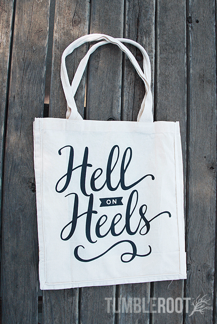 "Show off your country girl personality with this  ""Hell on Heels"" canvas tote bag!"