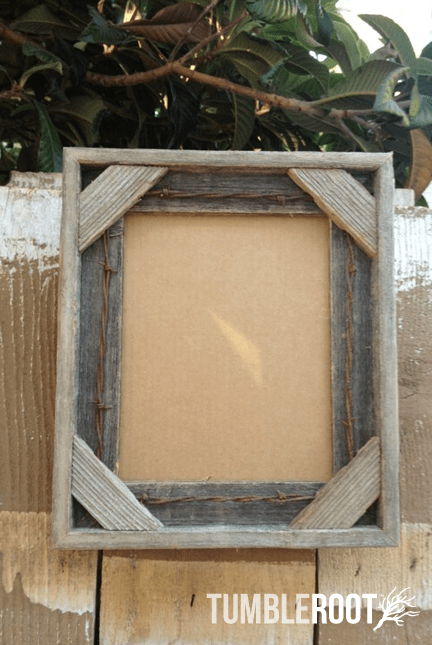 reclaimed up cycled handmade rustic barnwood frame with barbed wire border