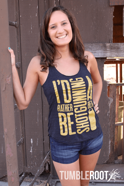 I'd Rather Be Shotgunning a beer country racerback metallic gold tank top! Marisa is 5'6 and wearing a size Small in this photo.