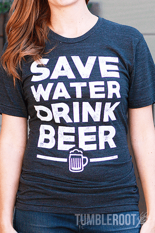 "The classic beer-drinker's motto, ""Save water drink beer,"" brought to life on our comfortable tri-blend t-shirt! A great beer festival shirt! Quincy is 5'4 and wearing a size Extra Small."