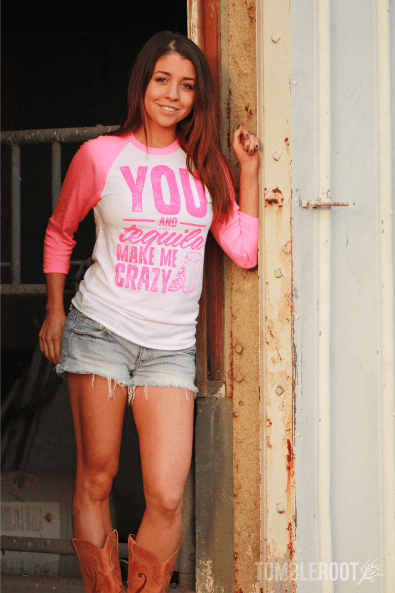 "Adorable country music inspired neon pink 3/4 sleeve raglan shirt - ""you and tequila drive me crazy"". Paige is 5'4 and wearing a size small."
