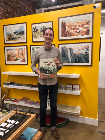 Chris Turnham with book and art