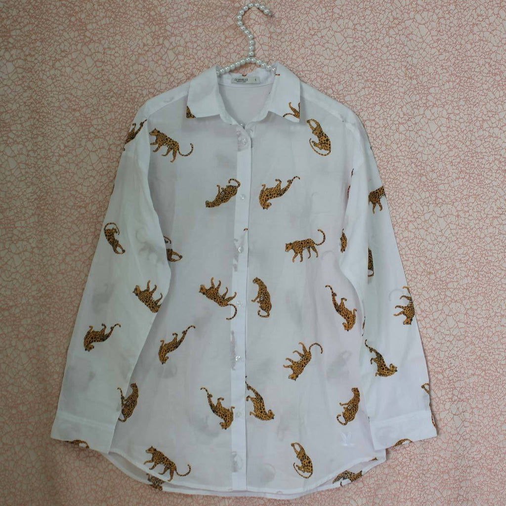 White cheetah all over print blouse