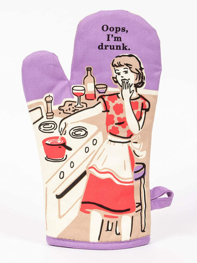 "Purple oven mitt with woman cooking in kitchen that says ""Oops, I'm Drunk"""