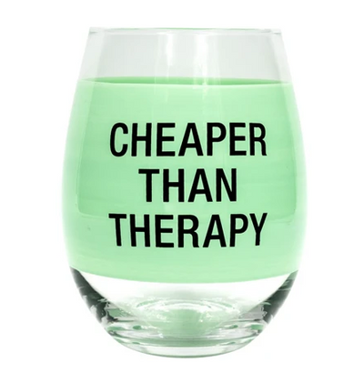 "Green tinted stemless wine glass with text ""Cheaper than therapy"" on it."
