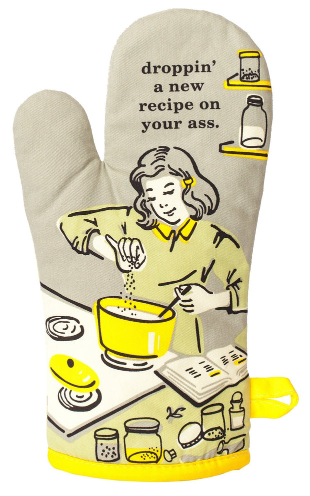 "Tan Oven mitt with black and yellow picture of a woman cooking that says ""Droppin' a new recipe on your ass."""