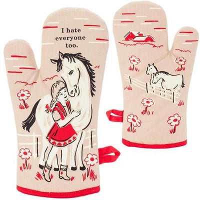 "Tan and red oven mitt with girl and her horse that says ""I hate everyone too"""