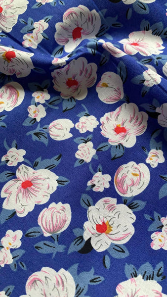 White flower on bright Blue Cotton lawn - Deadstock fabric on AmoThreads