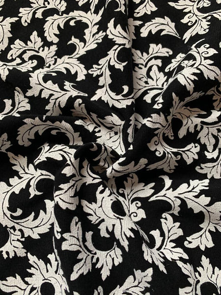 White holly leaf print on black - Deadstock fabric on AmoThreads