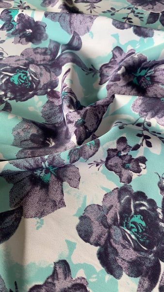 Amethyst/Aqua flower print on woven soft touch - Deadstock fabric on AmoThreads