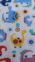 Multi coloured Dinosaurs on pale Pink Cotton Sateen - Deadstock fabric on AmoThreads