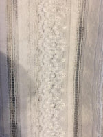 Ivory directional stretch lace with silver lurex thread