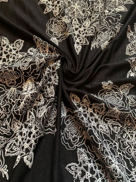 White placement flower print on black knit - Deadstock fabric on AmoThreads
