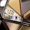 "Kirk Kara ""Charlotte"" 18K White Gold Blue Sapphire Diamond Three Stone Engagement Ring On Side"