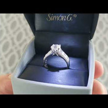 "Load and play video in Gallery viewer, Simon G. Large Center ""Simon Set"" Horizontal Baguette Diamond Engagement Ring"