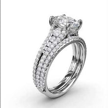 Load and play video in Gallery viewer, Fana Oval Triple-Row Tapered Diamond Engagement Ring