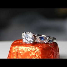 "Load and play video in Gallery viewer, Kirk Kara ""Dahlia"" Marquise Cut Blue Sapphire Diamond Engagement Ring"