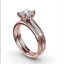 Load and play video in Gallery viewer, Fana Round Cut Four Prong Rose Gold Milgrain Solitaire Engagement Ring