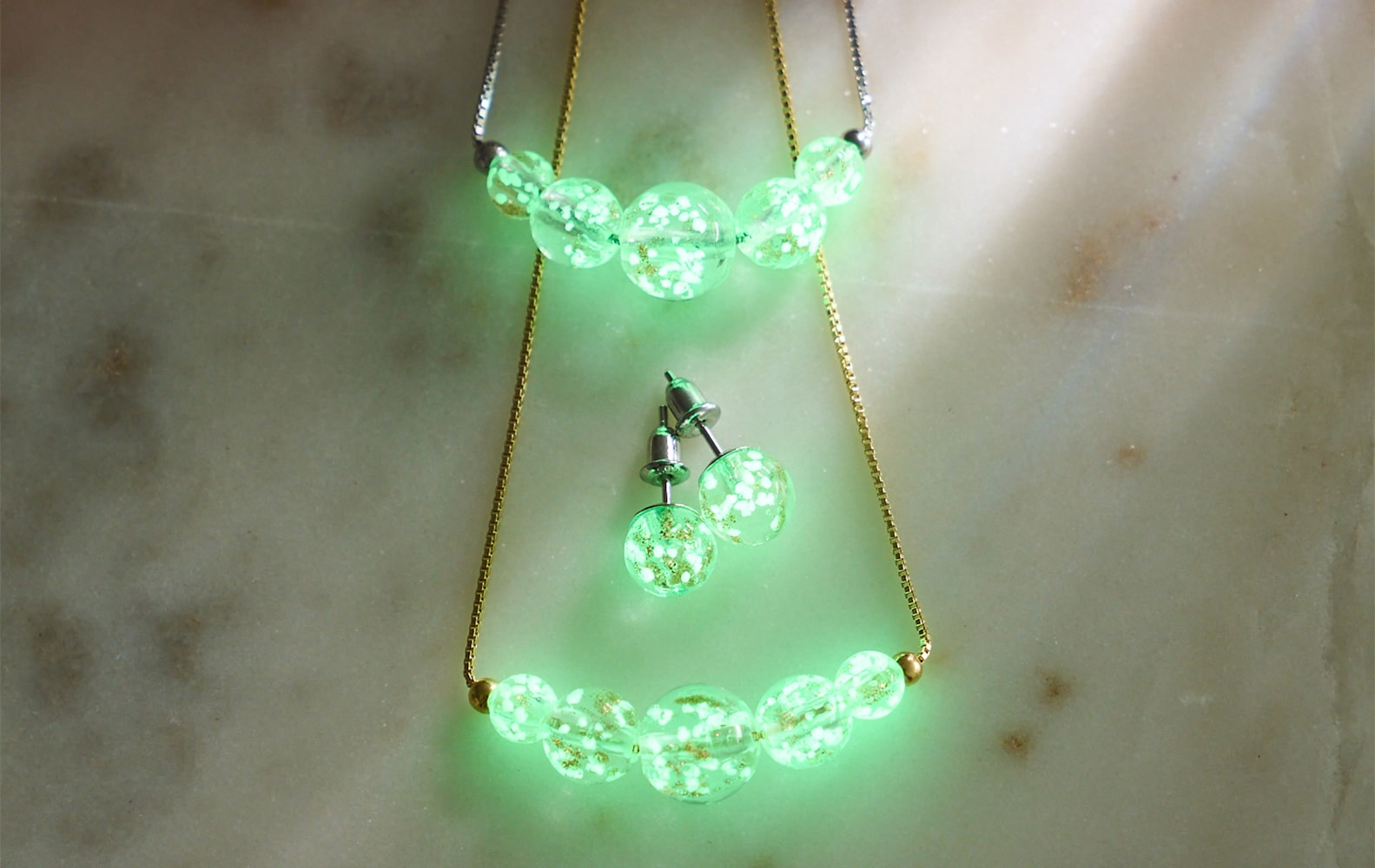 NOGU Glow in the Dark Firefly Glass necklace and earring set