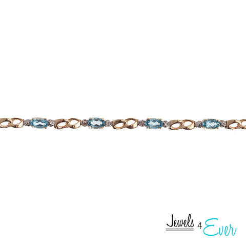 10K Yellow Gold 5 x 3mm genuine Blue Topaz and Diamond Bracelet