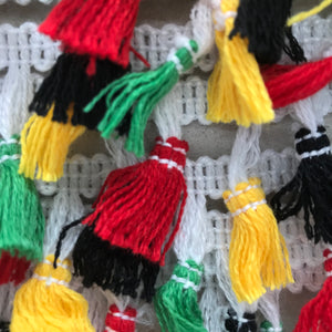 Black, yellow red and green tassle fringe trim