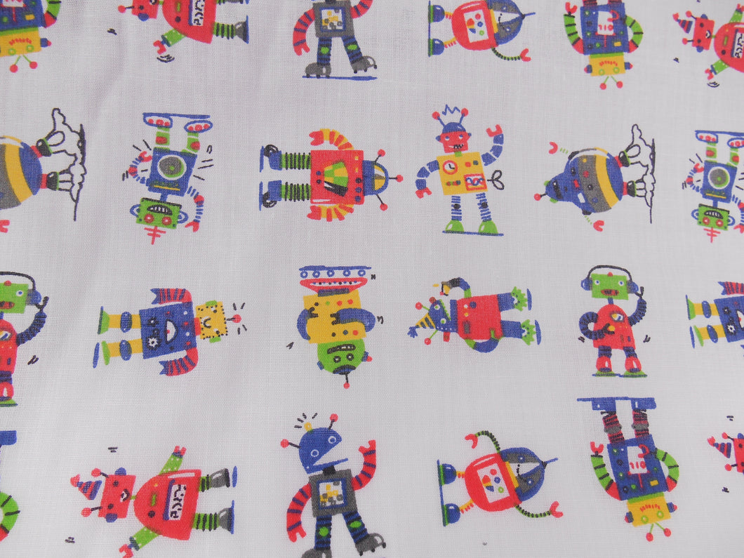 Robots on white polycotton fabric