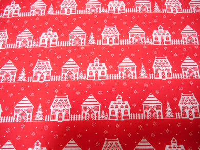 Red Christmas Themed Fabric with white Houses Polycotton fabric