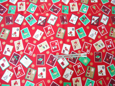 Festive Stamps on a red background cotton fabric