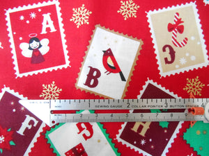 Christmas cotton fabrics with a festive stamps theme