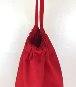 Red plastic bag holder dispenser with draw string