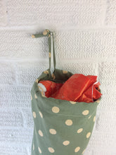 Load image into Gallery viewer, Green with large spots plastic bag dispenser with a draw string and elastic bottom