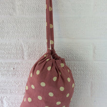 Load image into Gallery viewer, Plastic bag dispenser, dusky pink with large spots and a draw string