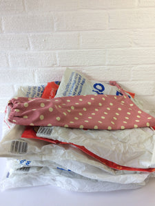 Plastic bag dispenser, dusky pink with large spots and a draw string