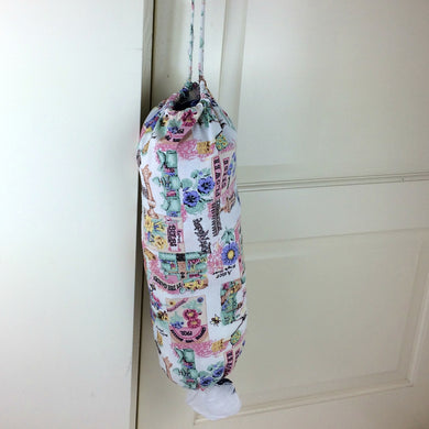 Plastic bag dispenser with a garden theme in pink with draw string and elastic bottom