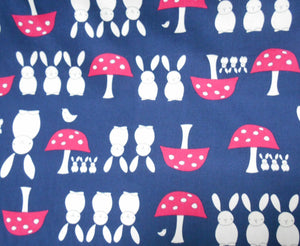 Bunnies and Toadstools on a navy Background cotton Fabric