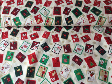 Festive Stamps on a cream background cotton fabric
