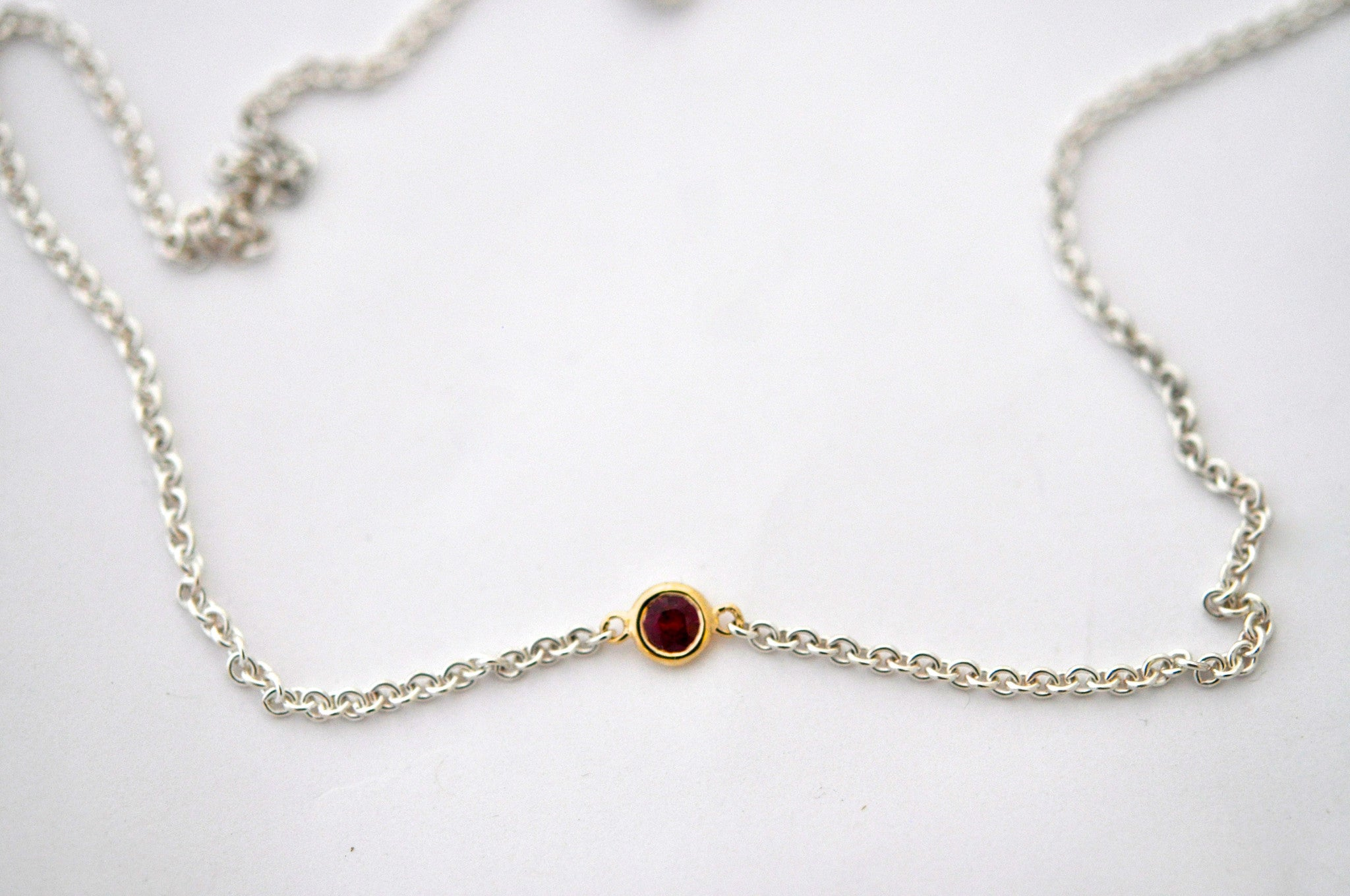 necklace / silver + small gemstone in gold bezel