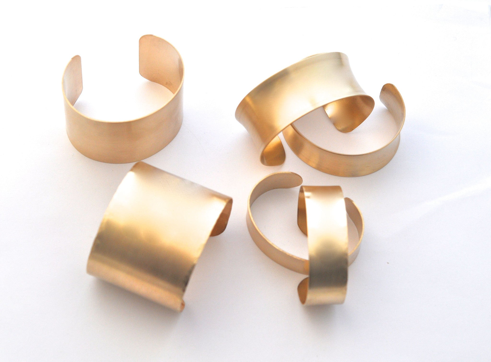 bracelet / brass cuffs with flared edges
