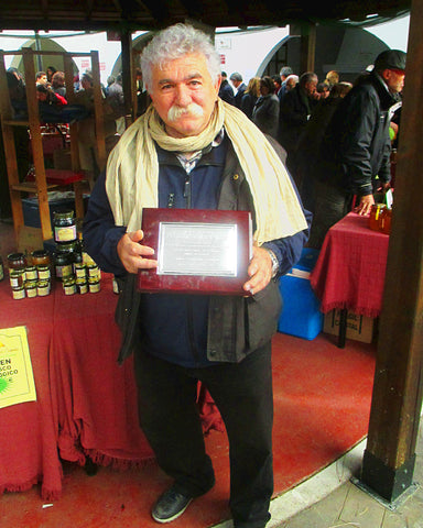 Beekeeper Antonio Simon with Award - Raw Honey Shop