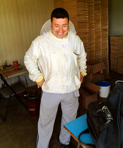 Ivan in his beekeeper's suit ready to harvest raw honey