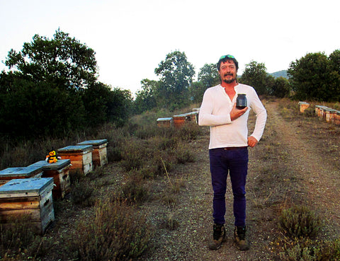 Ramon with Bee Hives and Raw Honey Jar