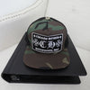Chrome Hearts Hollywood CH+ Trucker Cap in Camouflage Black