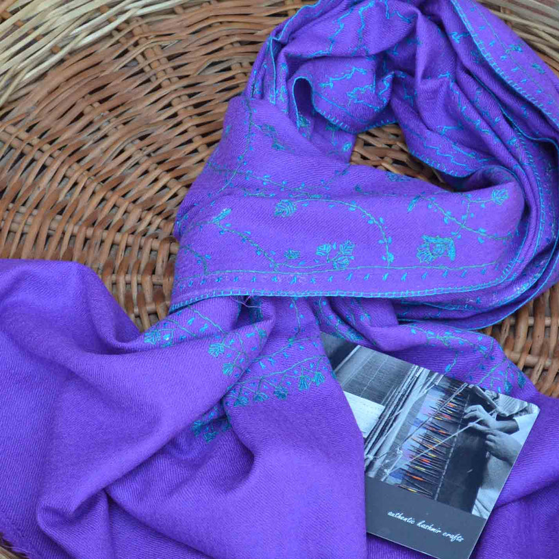 Pure merino woolen purple stole made with beautiful embroidery all over the scarf to make it look luxurious