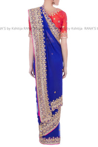 Beautiful blue saree teamed with orange blouse